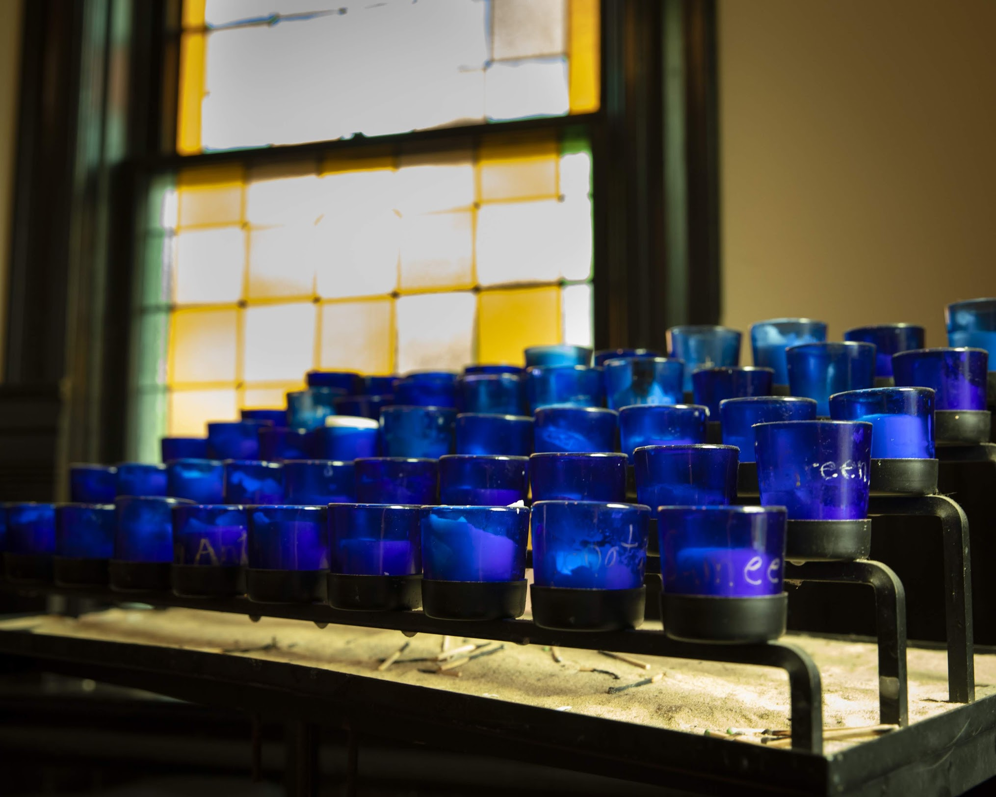 Candles lined up on an altar