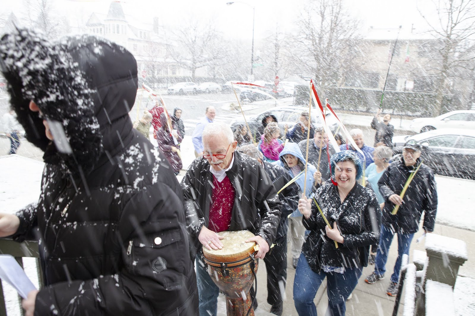 Parishioners signing in a light snowfall